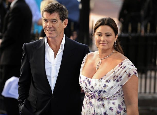 """British actor Brosnan poses as he arrives for the world premiere of """"Mamma Mia"""" in London"""